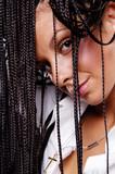 attractive woman looking through her dreadlocks poster