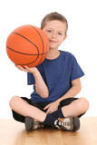 6-7 years old boy with basketball