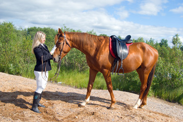 beautiful girl and her handsome horse.Friendship