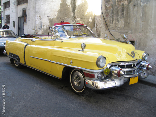 Yellow old cabrio car in Havana Cuba