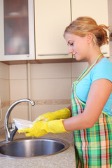 Happiness girl washes a plate 2