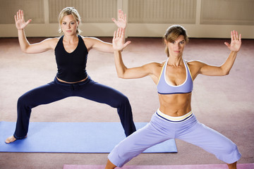 View of two women exercising.