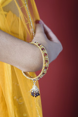 Close up of a woman in Indian clothing.