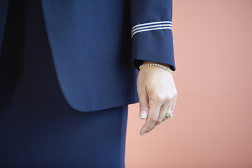 Midsection of a woman in a pilot uniform.