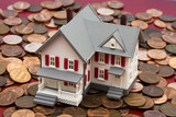 Model house on pile of coins – mortgage costs poster