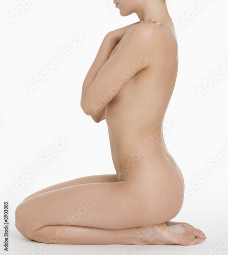 Profile of seated nude female