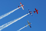 Stunt aircraft in formation, blue sky at air show performance poster