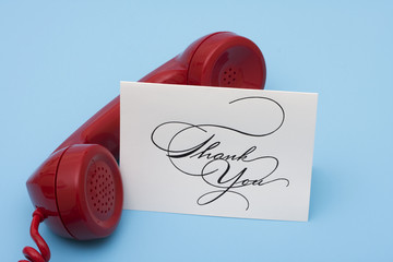 Telephone with thank you card with copy space
