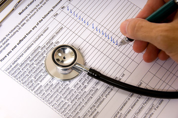 A doctor or nurse completing a patient questionaire