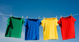 Fototapety a set of primary colored T-shirts hanging on a clothesline