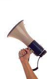 A caucasian hand holding a megaphone on a white background