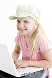 Young girl using a laptop computer over white background