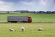 Truck passing by on a green agricultural field