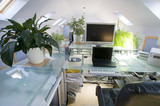 A home office in a converted loft poster