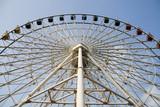 Ferris wheel in an amusement park poster