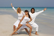 Three friends having fun at beautiful beach