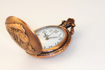 Railroad style pocket watch open on a white background