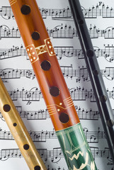 Flutes and whistle on note sheet