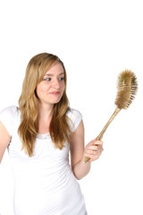 pretty woman with golden toilet brush