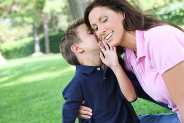 A mother and son having fun while playing in the park