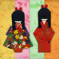 Two geisha origami friends on colored handpapers