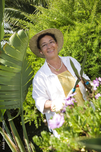 Portrait of senior Italian woman gardening