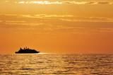 Nave passeggeri che naviga al tramonto poster