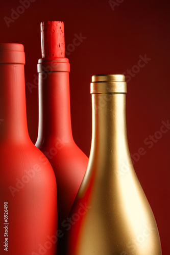 Two red and one gold bottle close-up