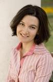 outdoor portrait of smiling brunet woman poster