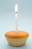 Plain cupcake with single white candle emphasising simplicity poster