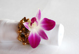 White napkin decorated with an orchid and precious stones. poster