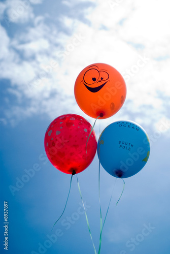 Deurstickers Ballon Three colored air balls on blue sky background