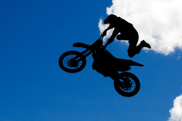 motocross rider making a high jump