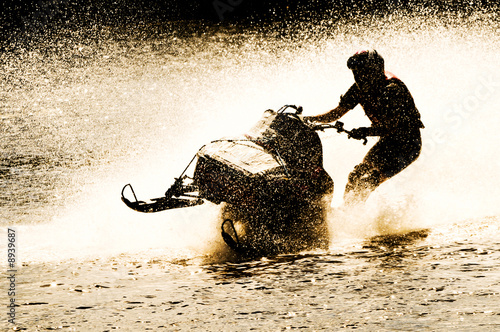 Fotobehang Water Motorsp. snowmobile driven on water