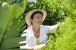 Portrait of senior Italian woman gardening