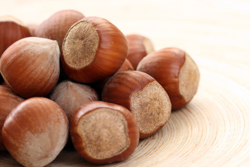 close-ups of hazelnuts on wooden table