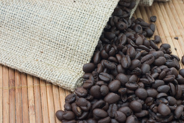 Coffee beans spilling out from bag.