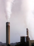 Power plant poluting the environment with smoke stacks poster