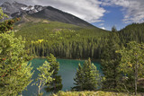Fine emerald lake in mountain woods of reserve poster