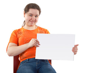 Young woman shows blank card isolated