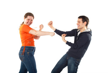 Young man and woman fighting isolated