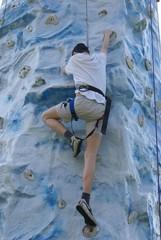 teenager climbing wall
