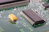 close up of a electronic hardware, silicon chips on a  board poster