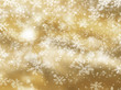 Golden background of falling snowflakes
