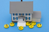 Smiley faces around a house , friendly mortgage company poster