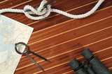 Nautical divider on a chart, rope and binoculars poster