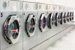 A row of industrial washing machines