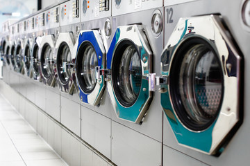 A row of laundromat washing machines