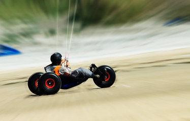 kite buggy going fast on the beach