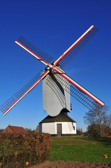 Windmill with blue sky background